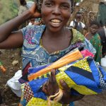 Sinziana Demian/IRC. Woman in Goma receives dignity kit.