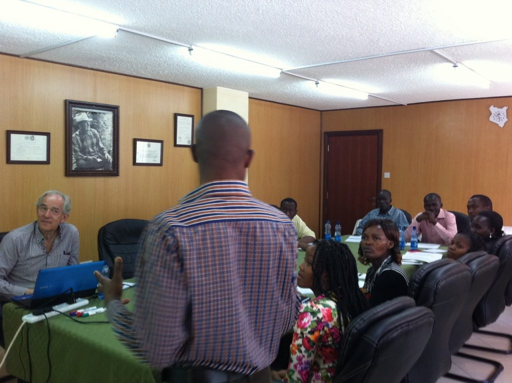 Paul Warambo, leading the group in a discussion