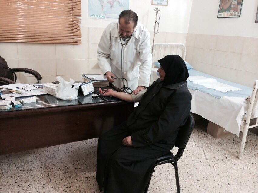 A patient receives a consultation at the IOM supported Taalabaya primary healthcare center. Photo credit Zeina Fahed IOM.