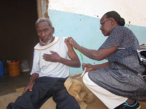 measuring middle upper arm circumference (MUAC) Tanzania September 2014