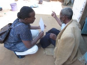 explaining the visual acuity test Tanzania Sep 2014