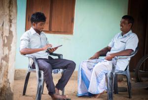 Oxfam volunteer capturing data