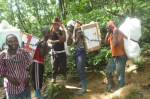 Community Health Workers Transporting drugs by head to remote inaccessible health facilities