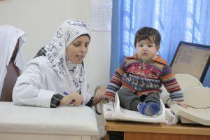 © UNRWA 2016 Photo by Mohammad Magayda A nurse measures Palestine refugee child weight at Irbid health Centre, Irbid, Jordan