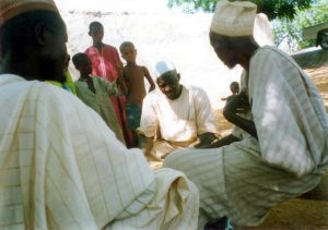 Men talking in Yabo district, northern Nigeria. © 2002 Center for Communication Programs, Courtesy of Photoshare