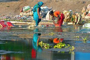 Women doing washing in a river in Kustiya Bangladesh. © 2014 Momo Mustafa Courtesy of Photoshare.