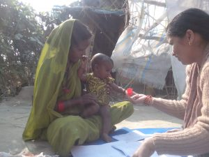 A child and a mother during child development test at baseline.