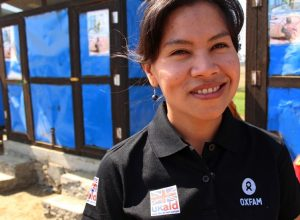 Mee Mee Htun, Public Health Engineering Officer, outside communal Tiger Worm Toilets in Say Tha Mar Gyi camp. Credit: Rhea Catada/Oxfam