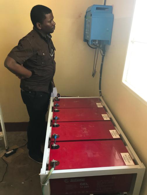 Inspecting our Solar Capacity/Mulamba, rural DRC, photo credit: Darcy Ataman