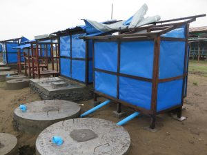 Cyclone Mora caused damage to roofs and doors in standard latrines (circular tank) & Tiger Worm Toilets (rectangular tank) in Say Tha Mar Gyi camp. Credit: Mee Mee Htun/Oxfam