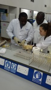 Jasmine Clark (LSHTM), David Opare (NPHRL) and Lawrence Henry Ofosu-Appiah preparing the samples for incubation of bacteria Escherichia coli at the National Public Health Reference Laboratory of Ghana. (Photographer: Enrique Raso/Action Against Hunger-Spain).