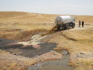 Faecal sludge being disposed of into a water body, Kurdish Region Iraq