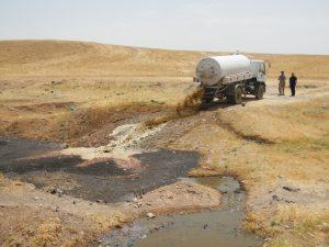 Faecal sludge being disposed of into a water body, Kurdish Region Iraq