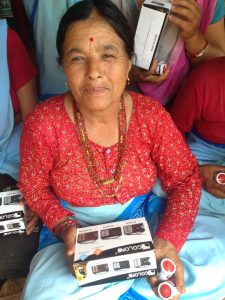 Nepalese women with a radio
