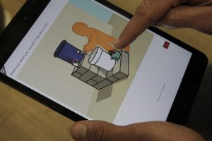 Tablet with illustration of person washing hands