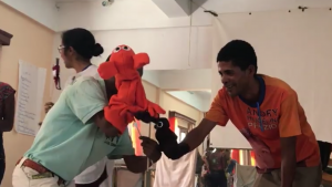 Soluf gives birth to Mr Poop – then wipes his butt. Hand-washing skit session, NSI workshop, Madagascar October 2017